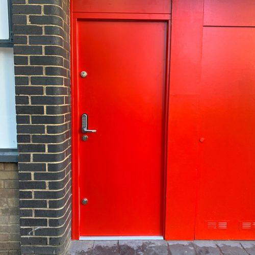 Red steel doors and internal window shutter